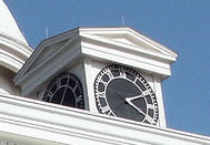 clock over entrance of capitol
