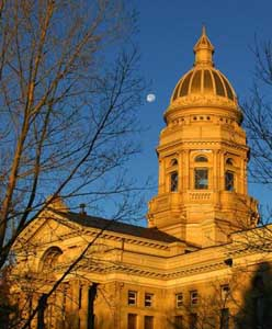 Wyoming capitol and moon at sunset